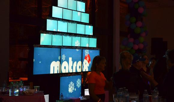 Matrox QuadHead2Go-Powered Video Wall Takes Corporate Holiday Partygoers Back to the Future