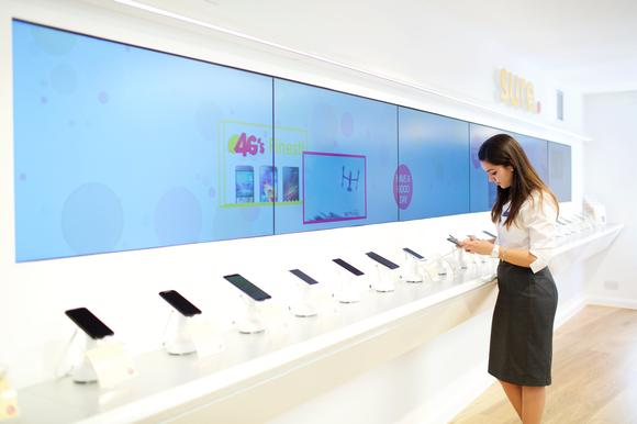 Unique Digital Signage Video Wall Strip Wraps Around Retail Store